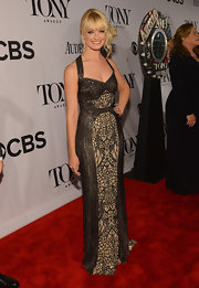 Beth Behrs wore this black and nude beaded lace gown for her red carpet look at the 2013 Tony Awards.