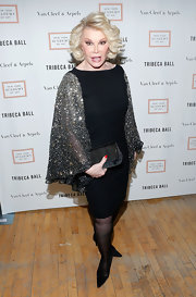 Joan Rivers sparkled as only Joan Rivers can when she sported this black cocktail dress that featured sequined angel-wing sleeves.