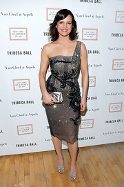 Carla Gugino sparkled in this silver sequined, one-shoulder dress, featuring black velvet detailing.