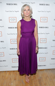Eileen Guggenheim looked elegant and mature in this bright purple gown with a full skirt.