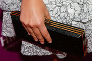 Sasha Pieterse paired a rectangular, hard-case clutch with her lace frock for a cool mix of textures.