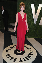 Judy Greer opted for a classic red gown with a deep v-neck for her evening look at the Vanity Fair Oscar party.