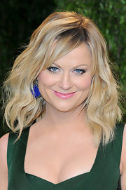 Amy Poehler opted for a pop of color at the Vanity Fair Oscar party with a pair of carved lapis earrings with a diamond border.