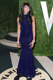 Naomi Campbell opted for a deep blue fitted gown for her Oscars Party look.