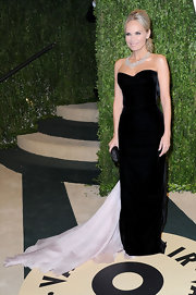 Kristin Chenoweth graced the Vanity Fair Oscar party with a black strapless gown with flowing train.