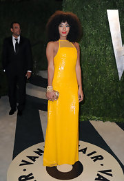 Solange Knowles showed her love of color at the Vanity Fair Oscar Party with this canary yellow gown with a stunning mesh halter.