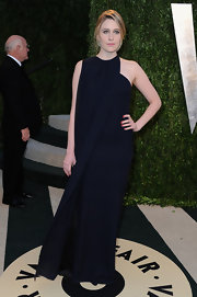 Greta Gerwig chose a simple but elegant navy wrap dress for her look at the Vanity Fair Oscars Party.