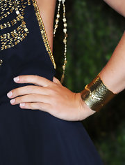 Maria Sharapova showed her edgier side with gold cuff bracelets, which she wore to the Vanity Fair Oscar party.