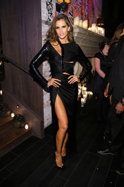 Izabel Goulart smoldered in a black Versace cutout dress with a thigh-baring slit during the Victoria's Secret fashion show after-party.