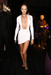 Candice Swanepoel was one hot babe at the Victoria's Secret fashion show after-party in this tight-fitting white Alexandre Vauthier Couture mini dress featuring a navel-grazing neckline.