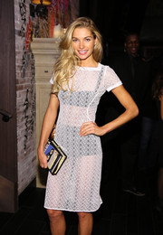 A 'Dracula' book clutch infused some fun into Jessica Hart's ensemble during the Victoria's Secret fashion show after-party.