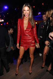 Alessandra Ambrosio looked absolutely fierce at the Victoria's Secret fashion show after-party in a red Anthony Vaccarello leather dress featuring a deep plunge and a triangle hem.