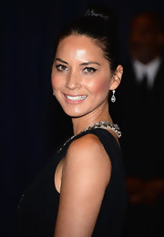 Olivia Munn pulled back her raven locks into this sleek classic bun.