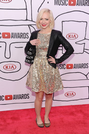Madilyn Bailey toned down her glittery dress with a black leather jacket.