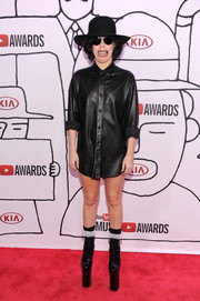 Lady Gaga wore a black leather button-down and no trousers when she attended the YouTube Music Awards.