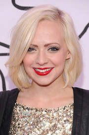 Madilyn Bailey's bright red lipstick provided a striking color contrast to her platinum blond locks.