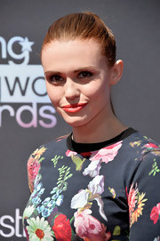 Holland's red lips had a touch of orange to them that complemented her fiery locks.
