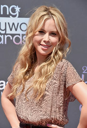 Tara pulled back her sunny blonde waves into a loose half updo for a soft and romantic look at the Young Hollywood Awards.