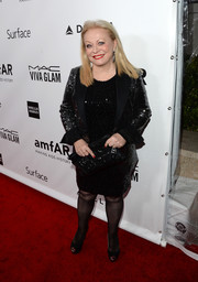 Jacki Weaver glittered in a sequined black skirt suit during the amfAR Inspiration Gala.