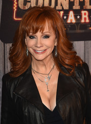 Reba McEntire sported a perfectly styled feathered flip with wispy bangs at the American Country Countdown Awards.