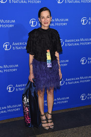 Cynthia Rowley looked funky-glam at the American Museum of Natural History Gala in a multicolored cocktail dress with a ruffle bodice and a feather skirt.