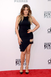Khloe Kardashian worked the American Music Awards red carpet in a Versus Versace LBD with an embellished, asymmetrical hem.