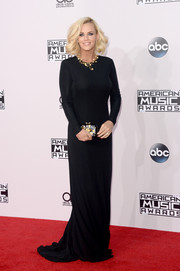 Jenny McCarthy styled her black dress with a colorful gemstone-inlaid clutch by Kotur.