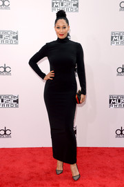 Tracee Ellis Ross looked svelte and elegant on the American Music Awards red carpet in a black turtleneck gown she designed together with Annabelle Harron.