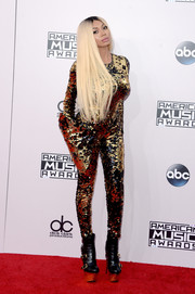 Dencia sealed off her attention-grabbing ensemble with a pair of sky-high, multi-buckled platform boots.