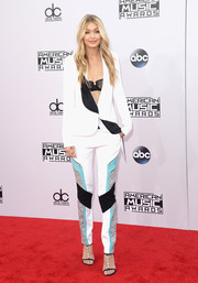 Gigi Hadid sported an androgynous-meets-sexy vibe at the American Music Awards with this white Prabal Gurung pantsuit accented with black, turquoise, and silver panels.