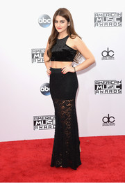 Lauren Giraldo paired her top with a long black lace skirt.