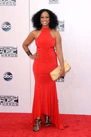 Garcelle Beauvais flaunted her curves in a body-con red fishtail gown by Michael Costello at the American Music Awards.
