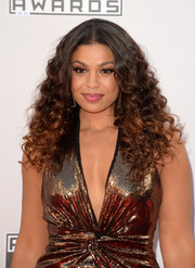 Jordin Sparks styled her hair with a center part and voluminous curls for the American Music Awards.