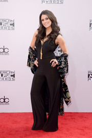 Brittany Furlan worked a '70s vibe in a black bell-bottom jumpsuit during the American Music Awards.