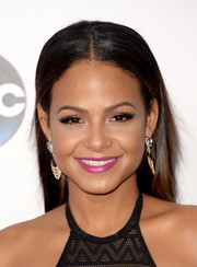Christina Milian opted for a simple center-parted hairstyle when she attended the American Music Awards.