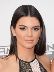 Kendall Jenner looked radiant with her glossy nude lipstick and metallic eyeshadow.