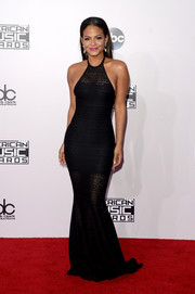 Christina Milian looked very curvy in her body-con black halter gown at the American Music Awards.