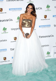Jessica Alba complemented her gorgeous gown with a studded gold Brian Atwood clutch.