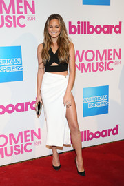 Chrissy Teigen looked very trendy in a black cutout crop-top by Yigal Azrouel during the Billboard Women in Music luncheon.