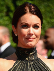 Bellamy Young finished off her glamorous ensemble with a pair of diamond cluster studs by Dana Rebecca Designs.