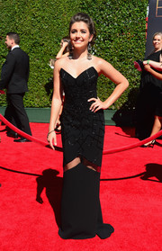 Ana Golja chose a black strapless gown featuring geometric beading and a see-through panel on the skirt for the Creative Arts Emmy Awards.