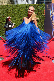 Heidi Klum twirled on the Creative Arts Emmy Awards red carpet, showing off a blast of fringe from her cobalt Sean Kelly gown.