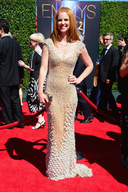 Sarah Rafferty managed to look seductive and classy at the same time in an intricately beaded sheer-illusion gown during the Creative Arts Emmy Awards.