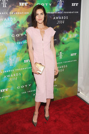 Hilary Rhoda added a dose of shine via an elegant gold box clutch.