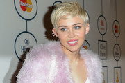 Miley Cyrus looked cute with her mussed-up pixie during Clive Davis' pre-Grammy gala.