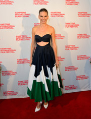Hilary Swank flaunted her enviable physique in a Delpozo strapless dress, featuring a midriff cutout and a geometric-patterned skirt, at the Hamptons International Film Festival.