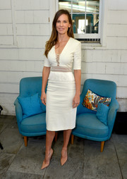 Hilary Swank looked svelte and ladylike at the Hamptons International Film Festival in a fitted white Altuzarra frock featuring a lace-up bodice and peplum detailing.