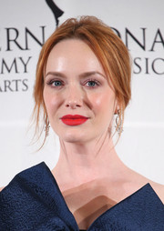 Christina Hendricks opted for a messy center-parted updo when she attended the International Emmy Awards.