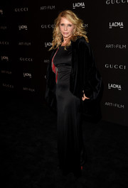 Rosanna Arquette arrived for the LACMA Art + Film Gala wearing a black velvet wrap over a column dress.