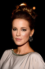 Kate Beckinsale attended the LACMA Art + Film Gala wearing her lush locks piled high on top of her head in a twisty bun.